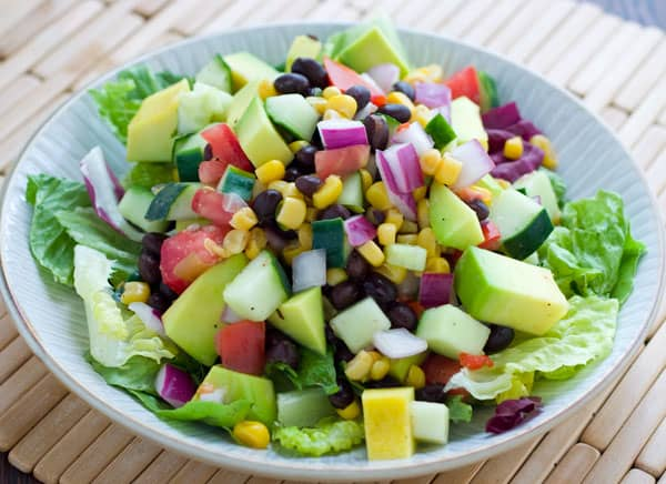 ... and easy salad has corn black beans avocados tomatoes cucumbers and