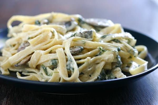 Lower Fat Fettuccine Alfredo with Spinach and Mushrooms by EclecticRecipes.com #recipe