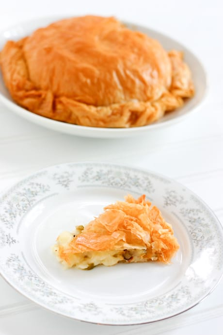 Olive Stuffed Baked Brie by EclecticRecipes.com #recipe
