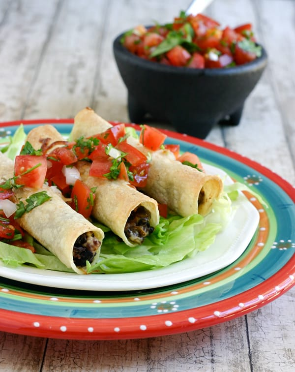Black Bean Chicken Taquitos by EclecticRecipes.com #recipe