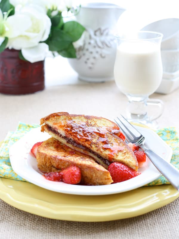 Nutella Stuffed French Toast with Maple Strawberry Syrup by EclecticRecipes.com #recipe