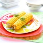Oven Roasted Corn with Basil Lime Butter @EclecticEveryday