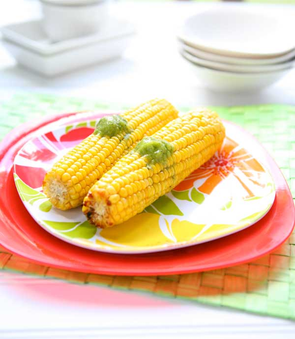 Oven Roasted Corn with Basil Lime Butter by EclecticRecipes.com #recipe