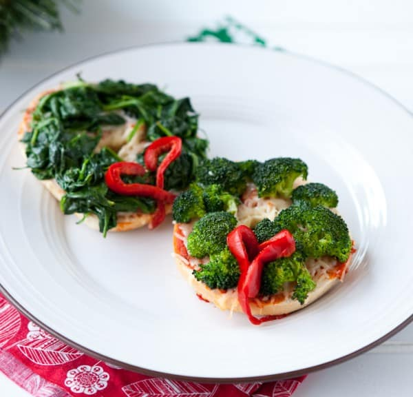 Christmas Pizza Bagel Wreaths by EclecticRecipes.com #recipe