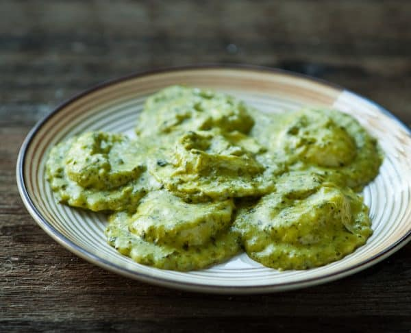 Ravioli with Basil Pesto Cream Sauce by EclecticRecipes.com #recipe