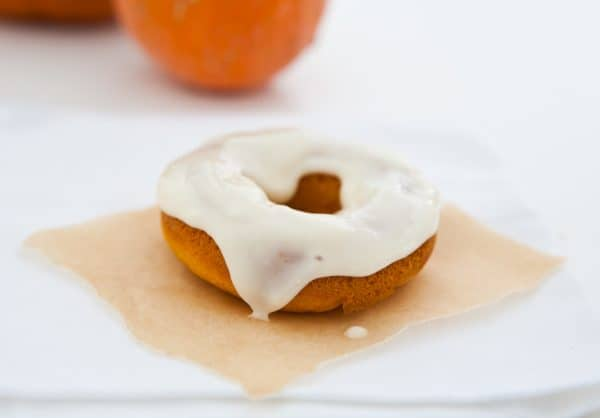 Baked Pumpkin Donuts with Cream Cheese Maple Icing by EclecticRecipes.com #recipe