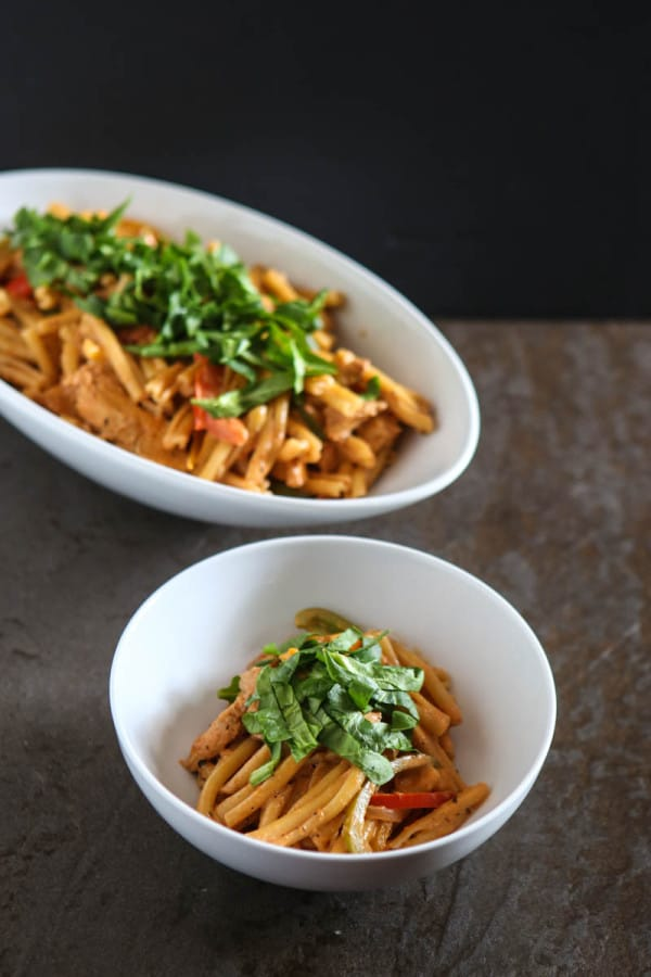 pasta in bowl and in large white oval bowl