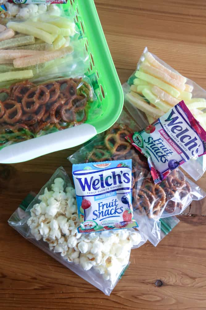 dry snacks inside green pantry bin with welch's fruit snacks