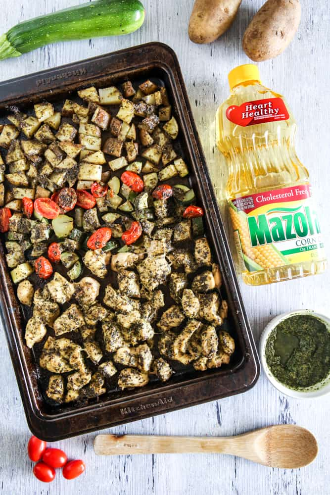 This Sheet Pan Pesto Chicken and Vegetables made is a delicious and easy recipe for busy weeknights! It's made better for you with simple swaps in the recipe too! #recipe #easyrecipe #sheetpan #sheetpanrecipe #chicken
