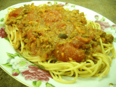 spaghetti in plate with pink flowers