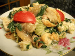 cheesy chicken pasta in old china bowl