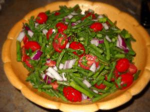 green bean asparagus salad in wood bowl