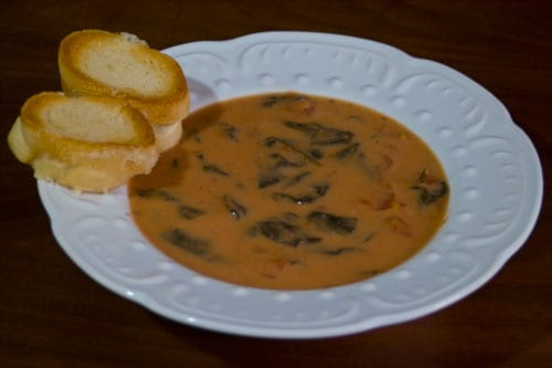 spinach tomato soup in white bowl