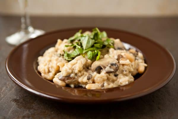 risotto on brown plate