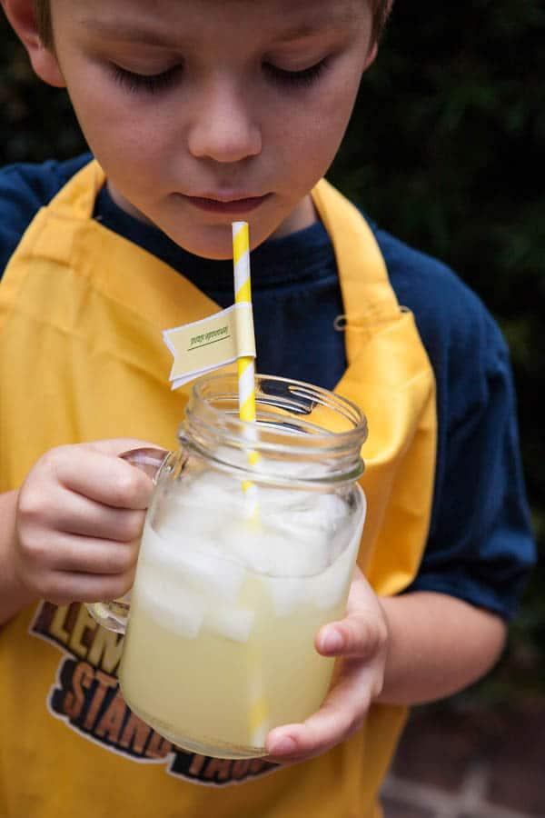 child looking at lemonade