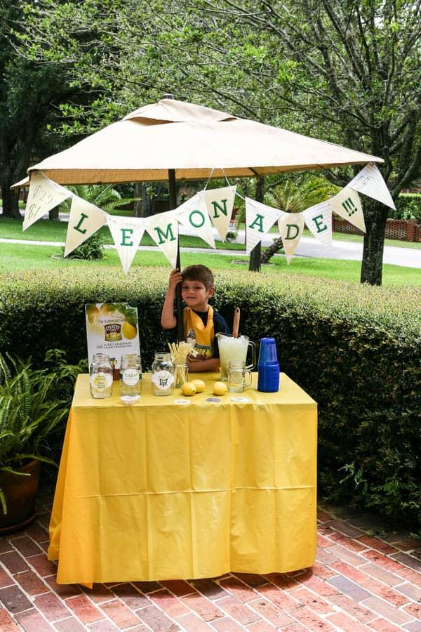 child at lemonade stand yellow