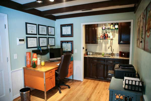 office with orange desk and wet bar