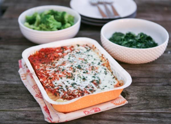 frozen vegetables and lasagna in orange pan