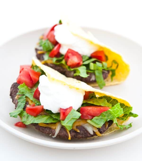 cheeseburger tacos on white plate