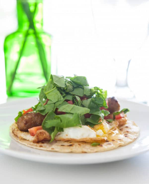 egg tacos on white plate