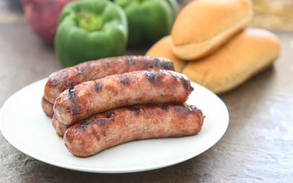 bratwurst with buns and vegetables