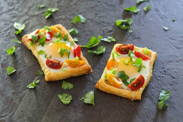 puff pastry egg tarts grey background with garnish