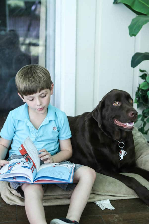 child next to dog