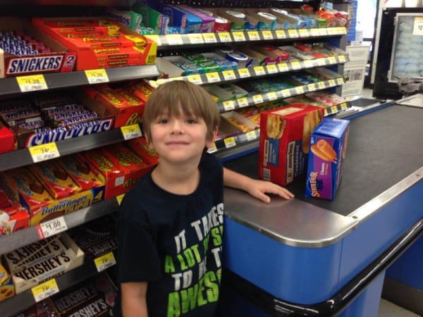 child standing beside checkout