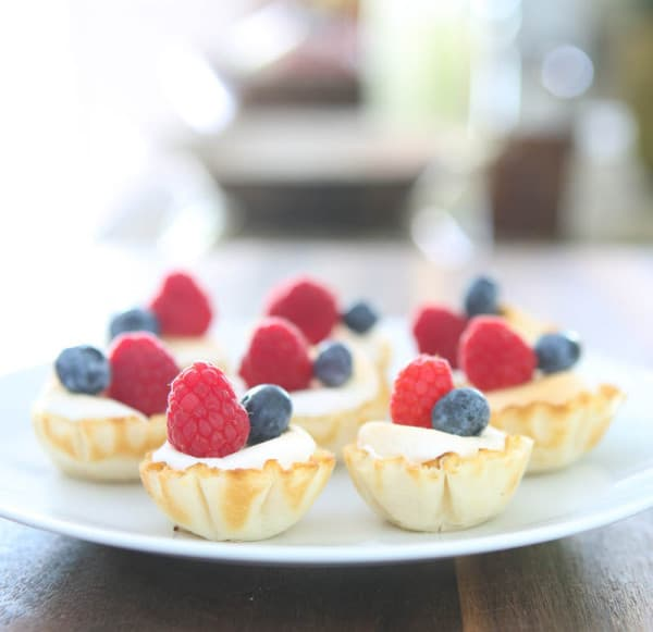 berry tarts on white plate