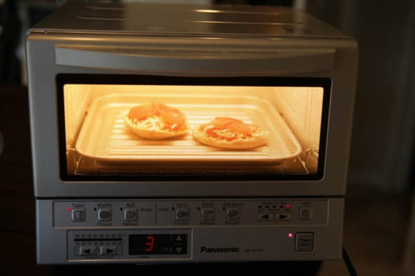 toaster oven with english muffins inside