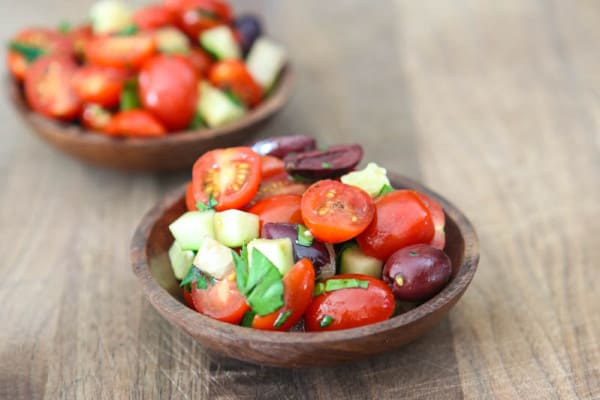 fresh tomato salad in brown bowls