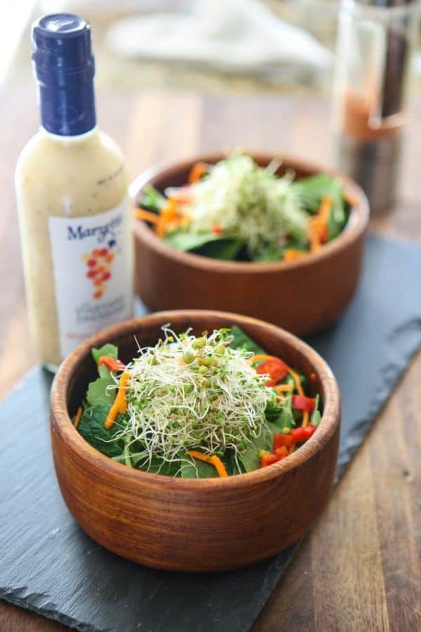 Asiago Peppercorn Kale and Sprout Salad in two brown bowls