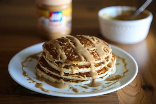 pancakes with peanut butter brown background