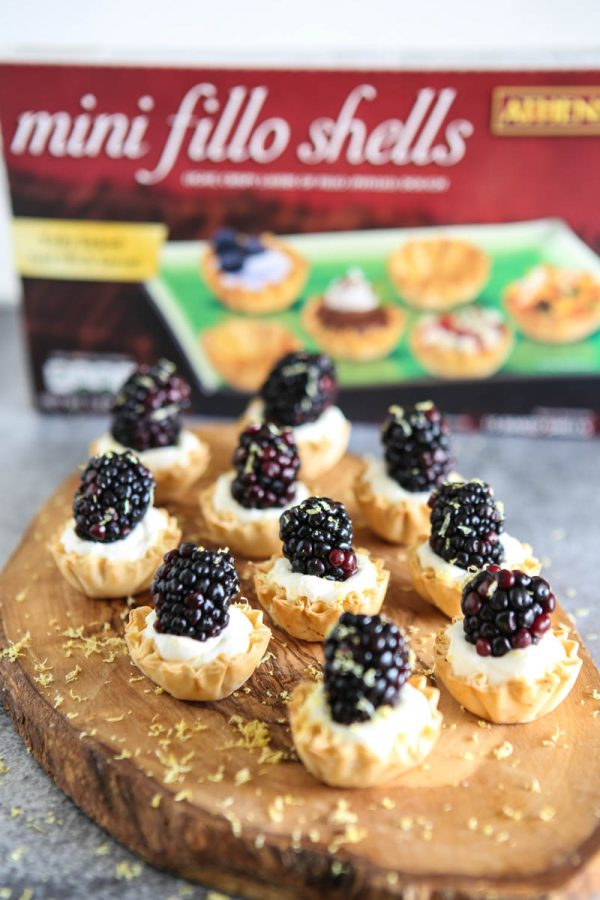 blackberry lemon cream tarts on cutting board