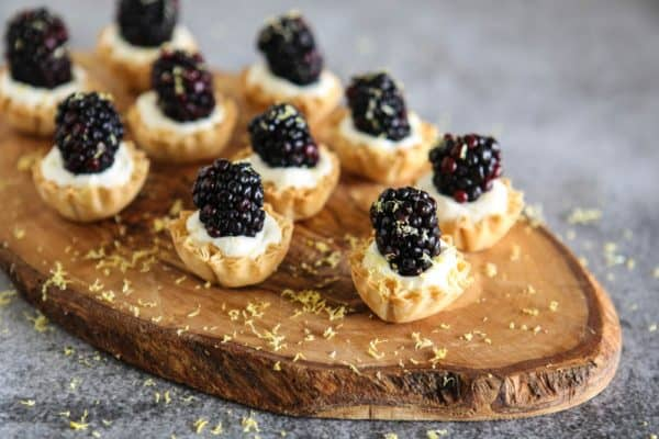 blackberry lemon cream tarts grey background