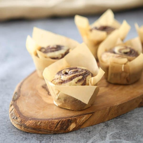 banana nutella muffins on wooden cutting board