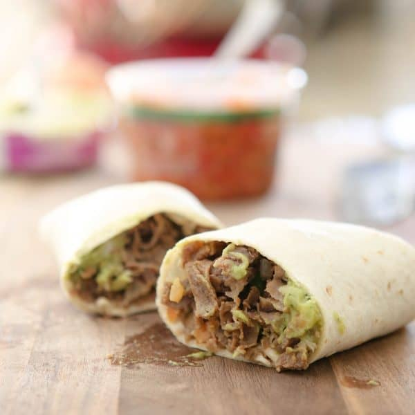 carne asada burritos on cutting board
