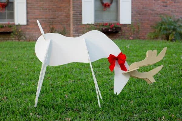 wooden reindeer eating grass