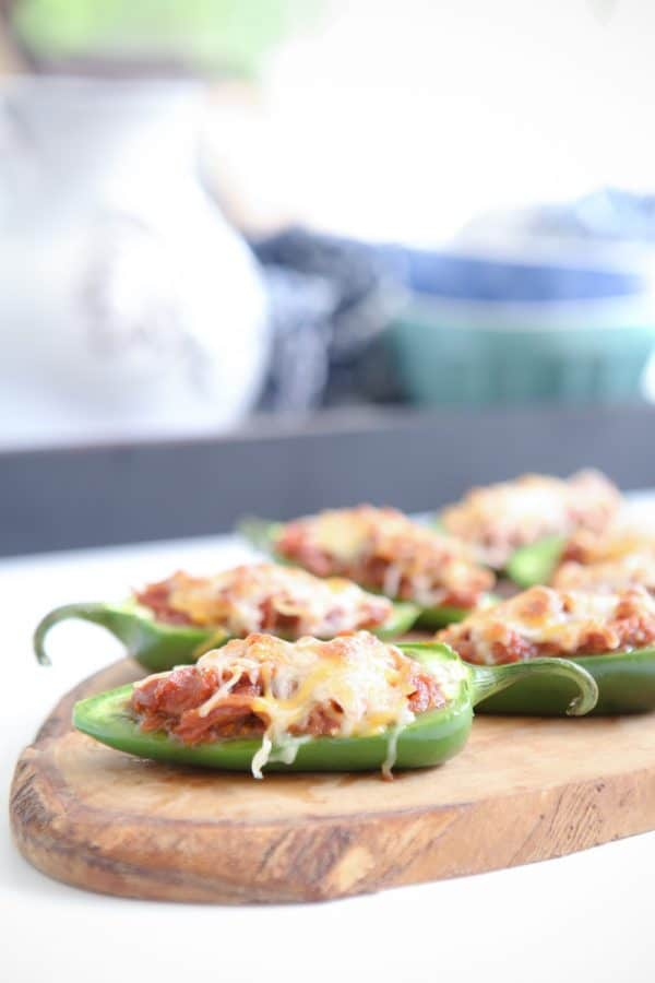 BBQ Stuffed Jalapeños on cutting board white background