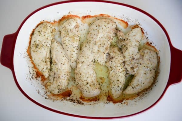 Roasted Lemon Garlic Herb Chicken in red pan