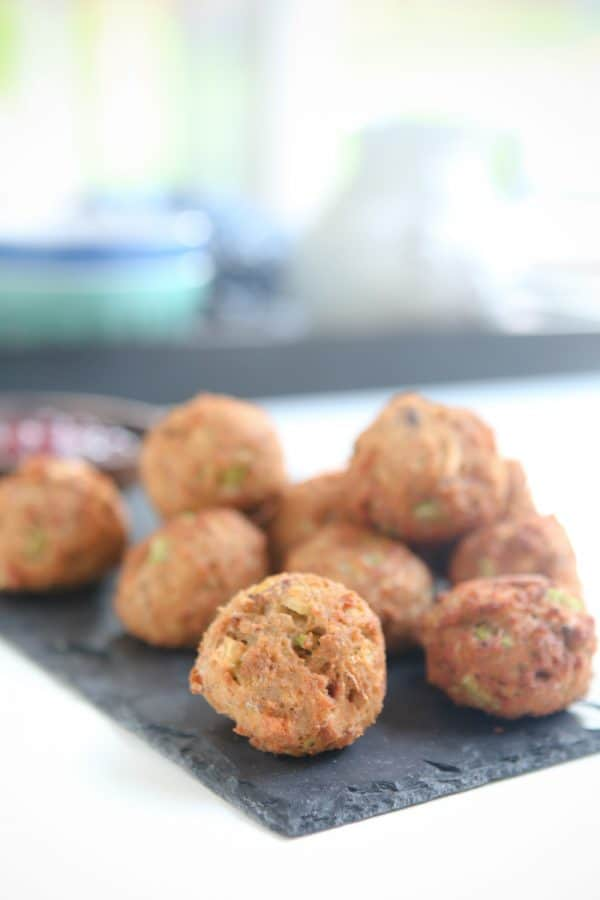These easy to make Deep Fried Stuffing Balls are perfect for Thanksgiving or Christmas! They are filled with apple, celery, onion and seasonings that make them incredibly flavorful! Serve with cranberry sauce for dipping and enjoy! #recipe #thanksgiving #christmas #dressing #stuffing