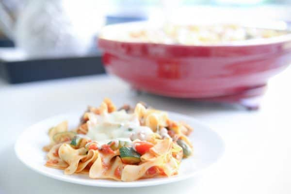 Chicken Cacciatore Noodle Bake on white plate and in red pan