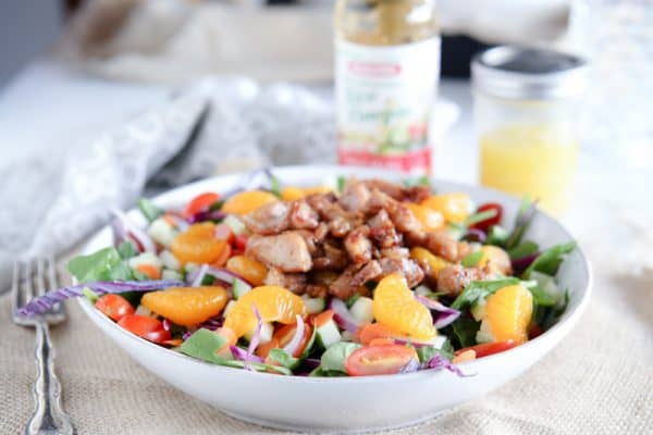 orange chicken salad with fork