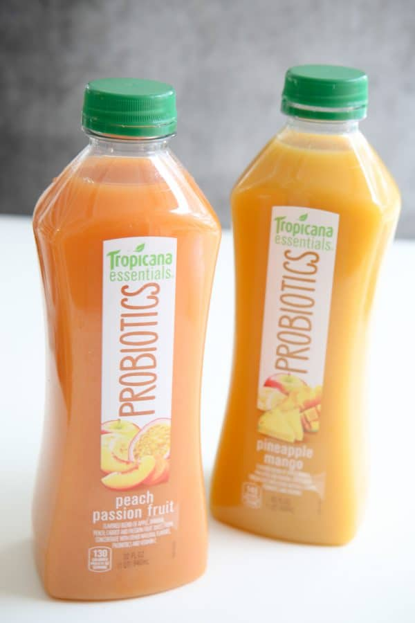 two bottles of tropicana probiotics white and grey background