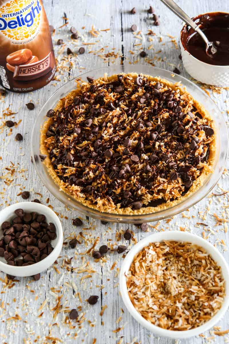 grey background with chocolate pie and coconut shavings on table