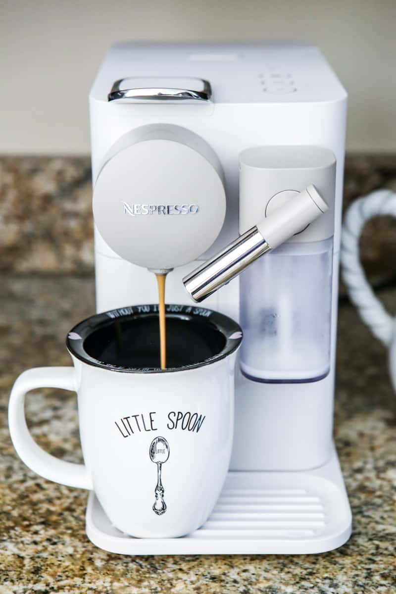 nespresso machine dispensing coffee