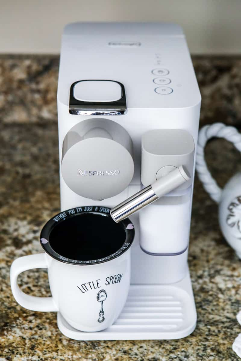coffee mug on nespresso machine