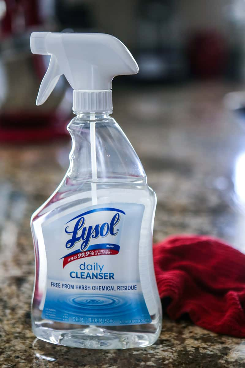 lysol spray and red rag on granite counter