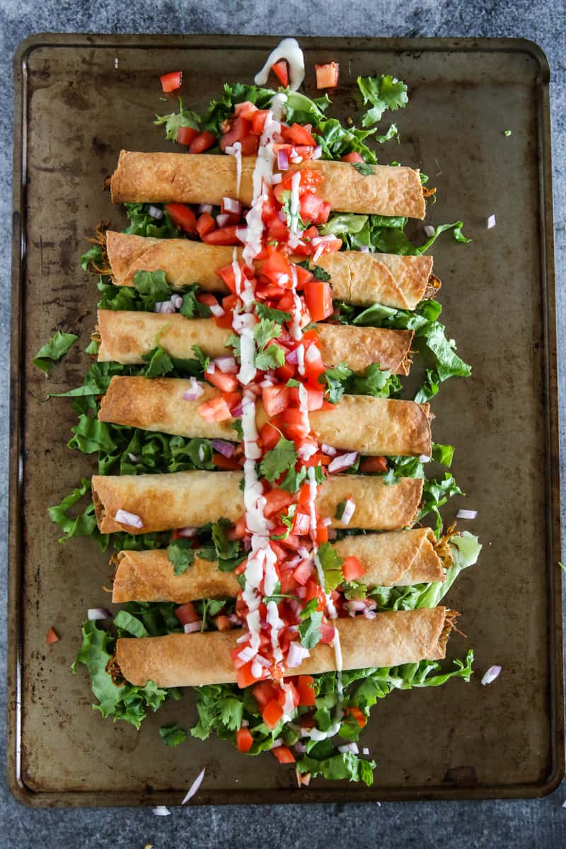 gluten free flautas overhead view on grey ban blue background