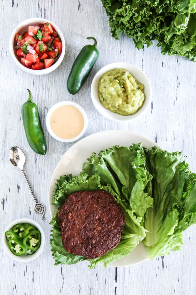 veggie burger in lettuce on plate